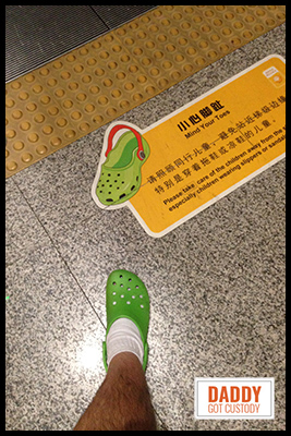 Fred Finds a Green Croc Sign in the Airport