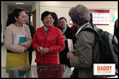 Debbe Roesler presents plaque to Principal Wu Qin