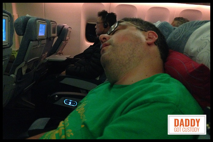 Sleeping on the Plane to China by https://www.DaddyGotCustody.com